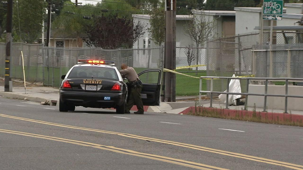 Los Angeles County sheriffs deputies investigate the scene of a man found shot to death in an unincorporated area of Gardena on Wednesday, July 8, 2015.