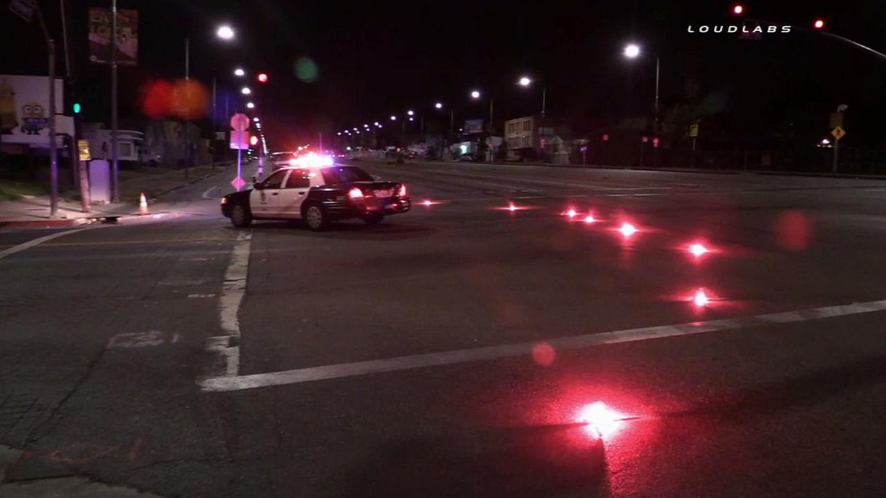Authorities investigate the scene of a hit-and-run crash near Leimert Park on Sunday, July 12, 2015.