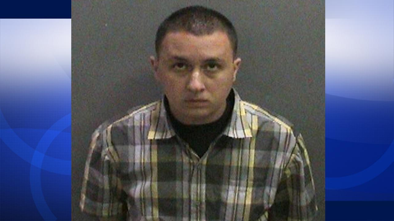 Darreck Enciso is shown in his booking photo.