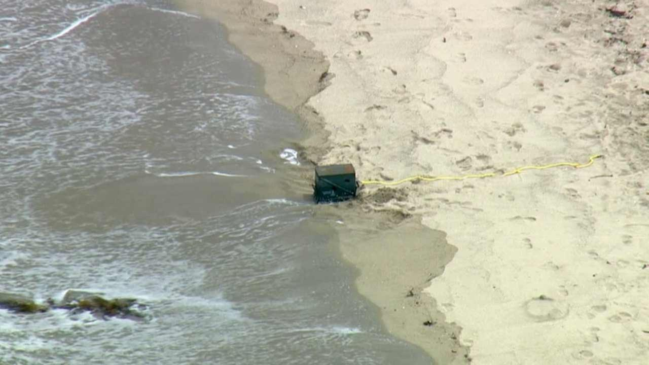 A military ammunition box marked explosives was found floating in the ocean about 200 yards off of the waterline at Ruby Street and the bike path in Redondo Beach Tuesday, July 21, 2015.
