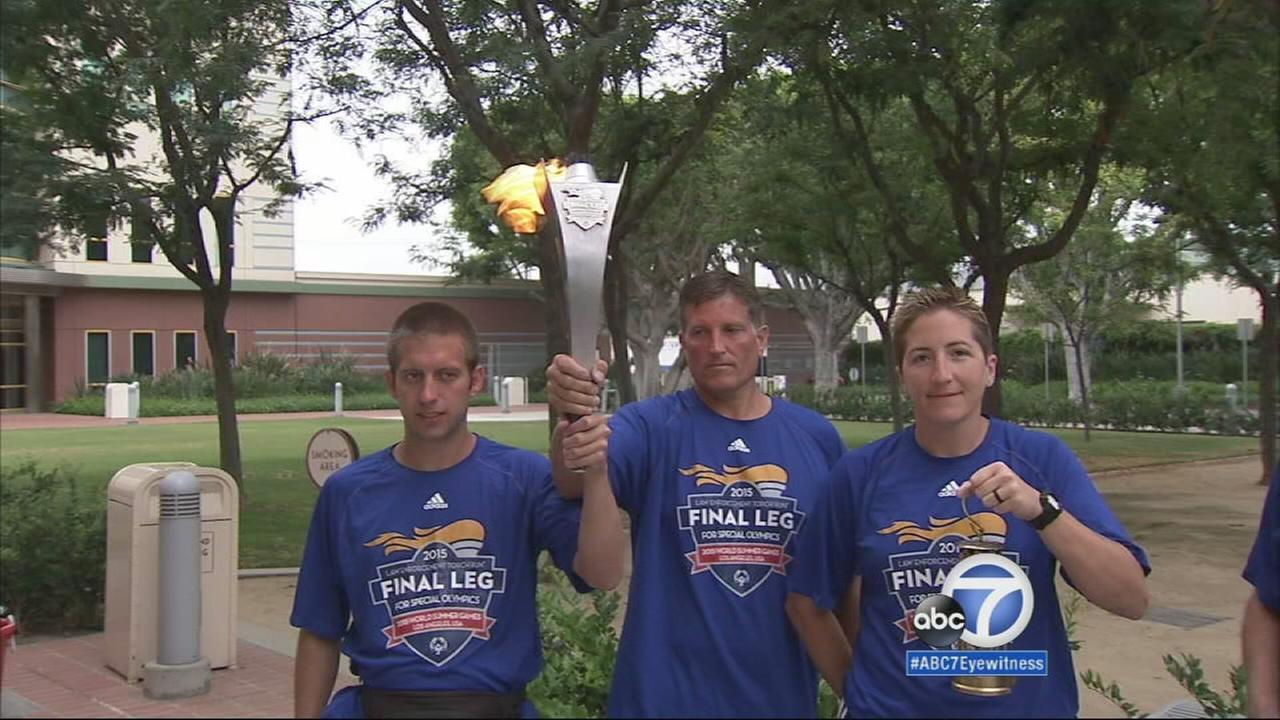 Special Olympics athletes and law enforcement officers participating in the torch relay brought the Flame of Hope to the ABC7 studio in Glendale on Wednesday, July 22, 2015.