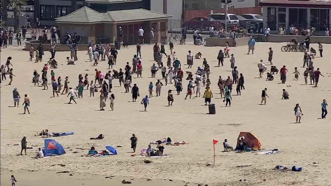 Hundreds flocked to Hermosa Beach Saturday, May 31, 2014 in search of hidden Angry Bird balls filled with cash.