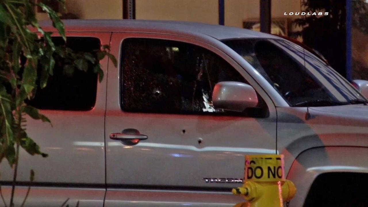 The victims truck is shown with bullet holes in the passenger side door and window on Friday, July 24, 2015.
