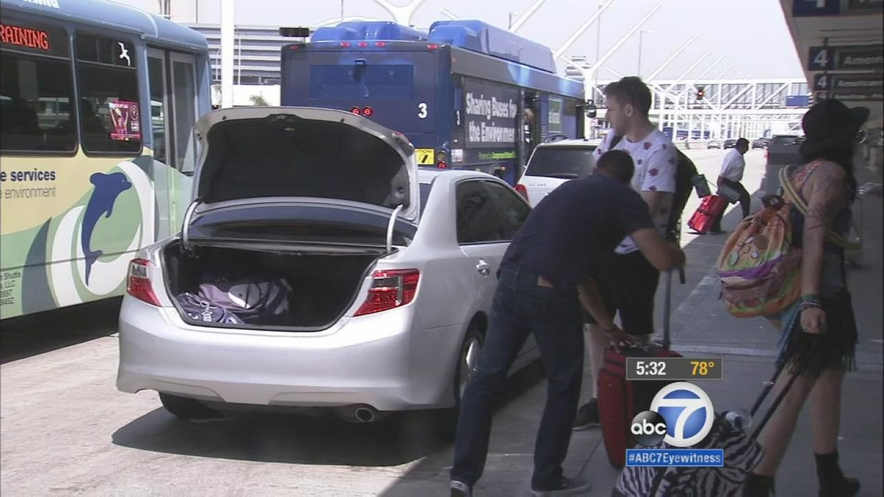 Six Los Angeles City Council members said Friday that they want to reconsider an approved plan that would allow ride-hailing services to legally pick up passengers from LAX.