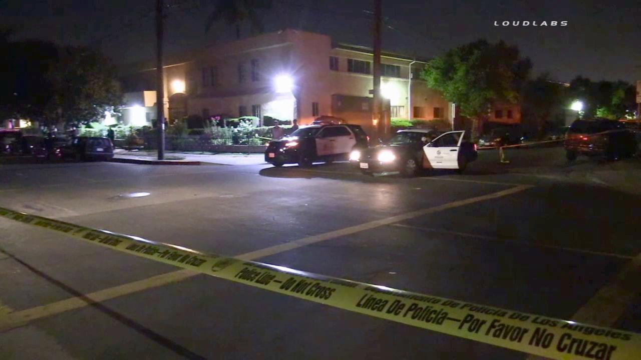 Crime tape ropes off the scene of a shooting in the 18000 block of Kittridge Street in Reseda on Monday, Aug. 3, 2015.