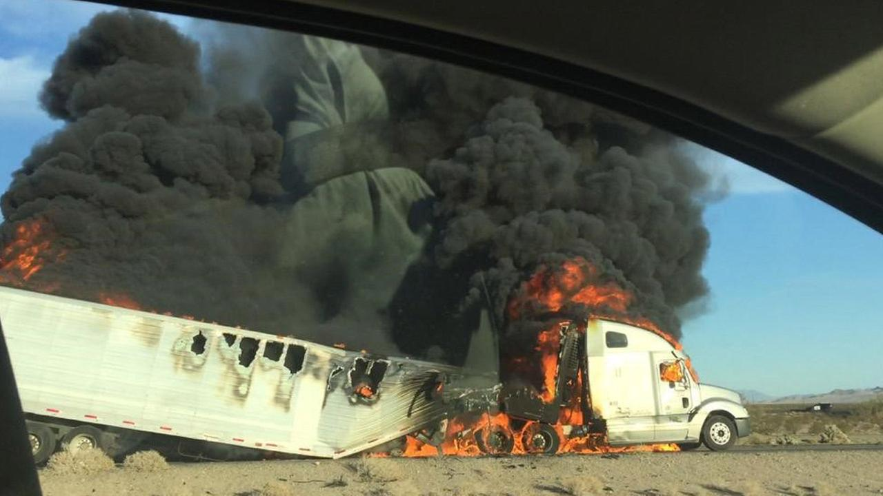 ABC7 viewer Miguel Mendoza captured flames and black smoke billowing out of a semi-truck on the southbound 15 Freeway in Baker on Monday, Aug. 3, 2015.