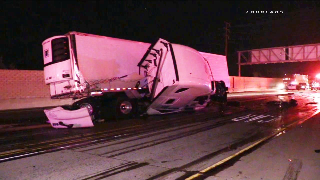 A big rig slammed into the center median and partially flipped over on the westbound 210 Freeway in the La Verne area on Tuesday, Aug. 4, 2015.