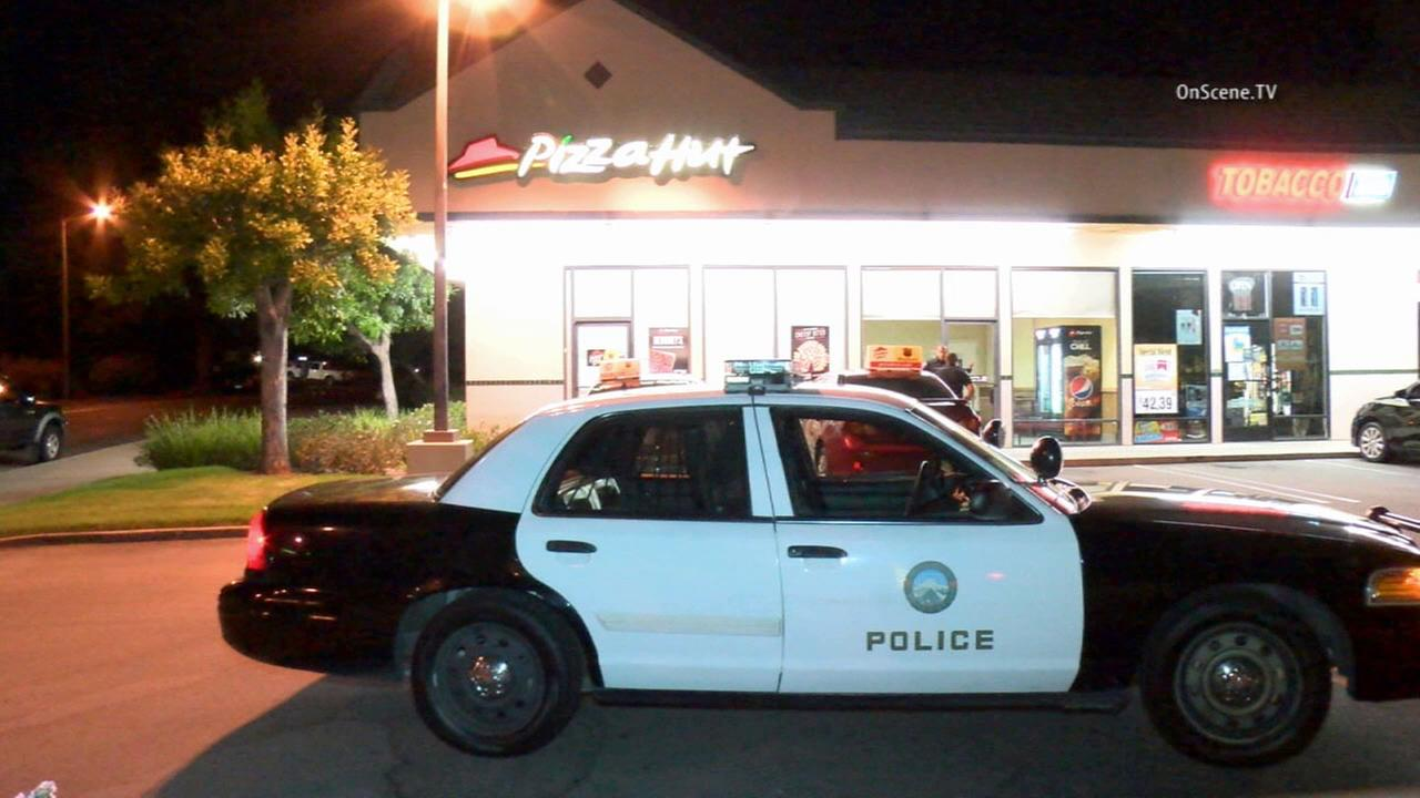 A police vehicle is parked outside of a Pizza Hut in the 900 block of East Yorba Linda Boulevard in Placentia, which was robbed Tuesday, Aug. 4, 2015.