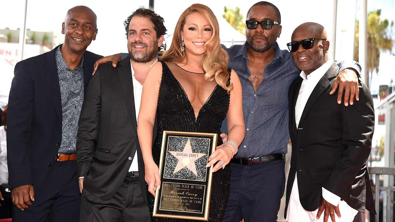 Stephen Hill, from left, Brett Ratner, Mariah Carey, Lee Daniels and L.A. Reid during a ceremony honoring Carey with a star on the Hollywood Walk of Fame on Wednesday, Aug. 5, 2015 in Los Angeles.