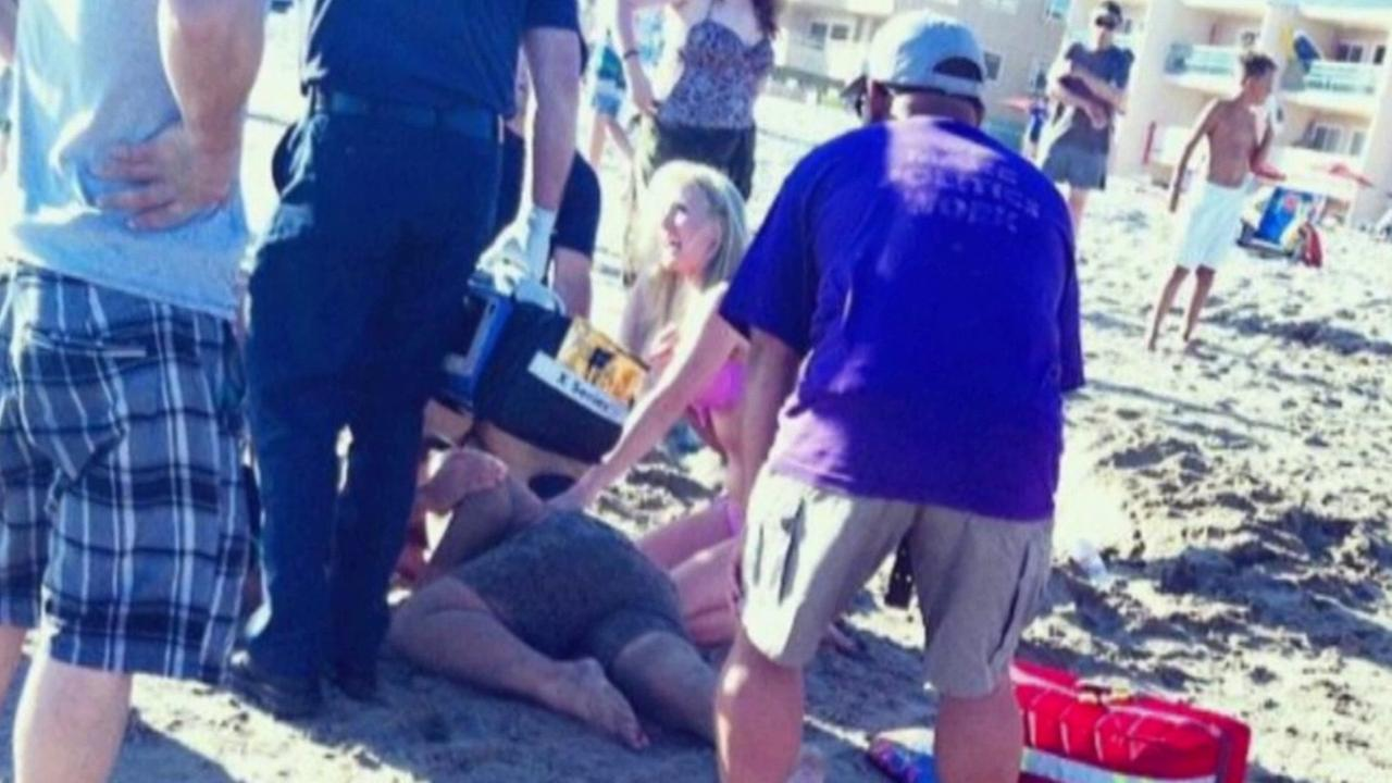 A 12-year-old boy is rescued after a sand tunnel collapsed on him at Carpinteria State Beach on Tuesday, Aug. 5, 2015.