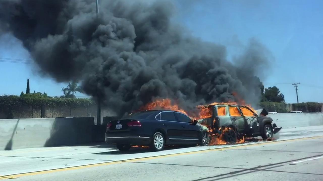 A fiery crash on the southbound 405 Freeway near the 22 Freeway was caught on video by an Eyewitness News viewer on Aug. 8, 2015.
