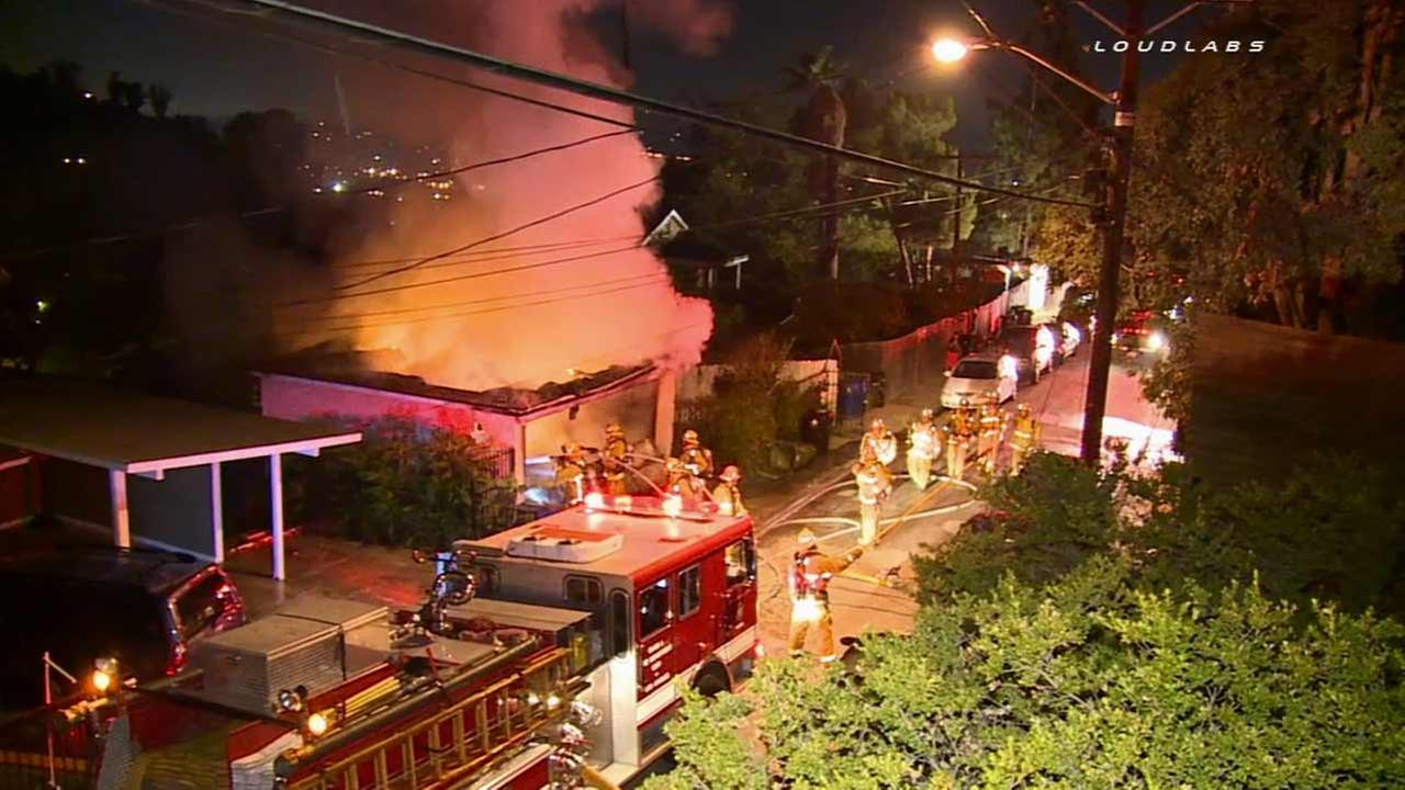 Los Angeles firefighters respond to a fire at a hillside garage in the 1800 block of W. Alder Drive in Cypress Park Sunday, Aug. 9, 2015.