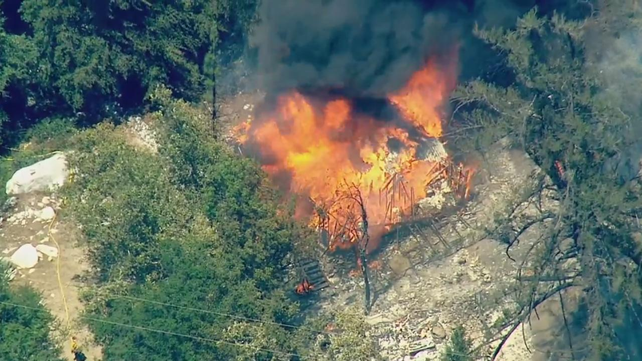 A brush fire in the hills north of Glendora burned a structure on Friday, Aug. 14, 2015.