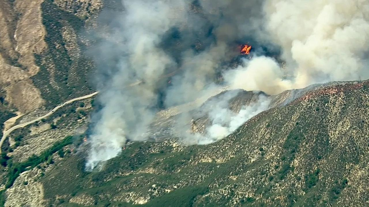 Flames and smoke are captured by AIR7 HD from a brush fire that erupted near Glendora on Friday, Aug.14, 2015.