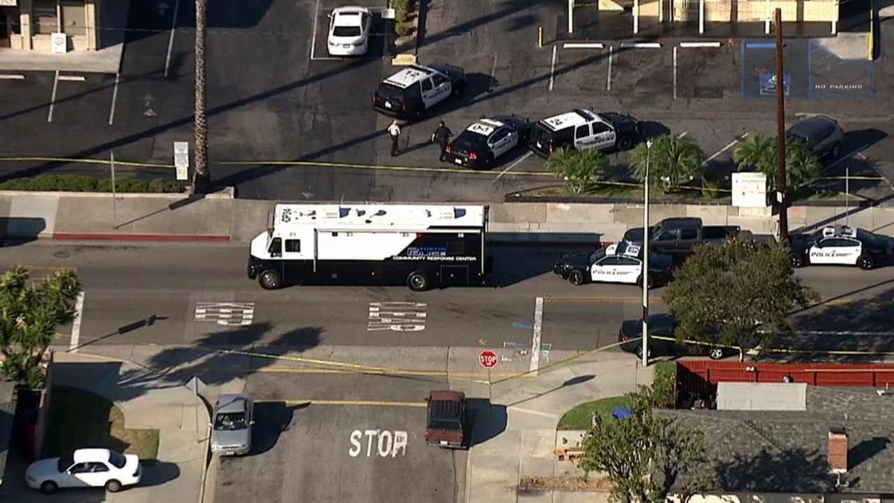 Tustin police respond to the scene of a stabbing near Red Hill and Mitchell avenues on Tuesday, Aug. 18, 2015.