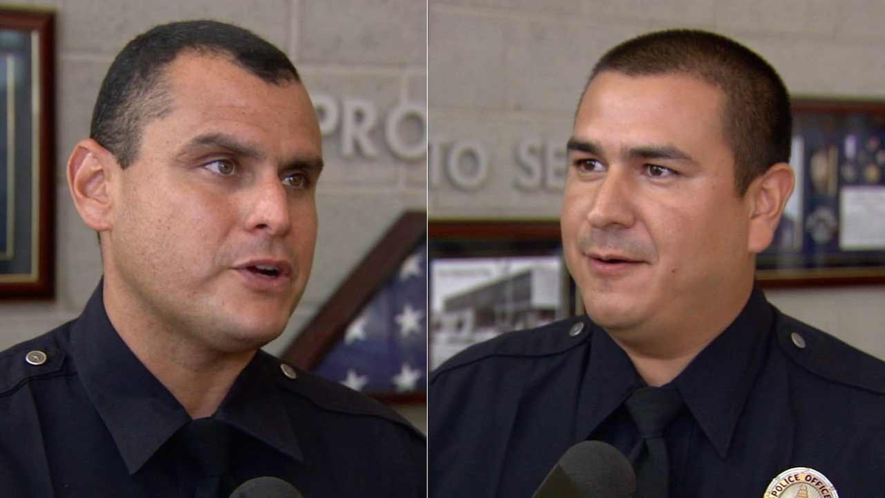 LAPD officers Jonathan Maldonado (left) and Alberto Ledesma (right) helped 14-year-old Christopher Cazales tie his tie.
