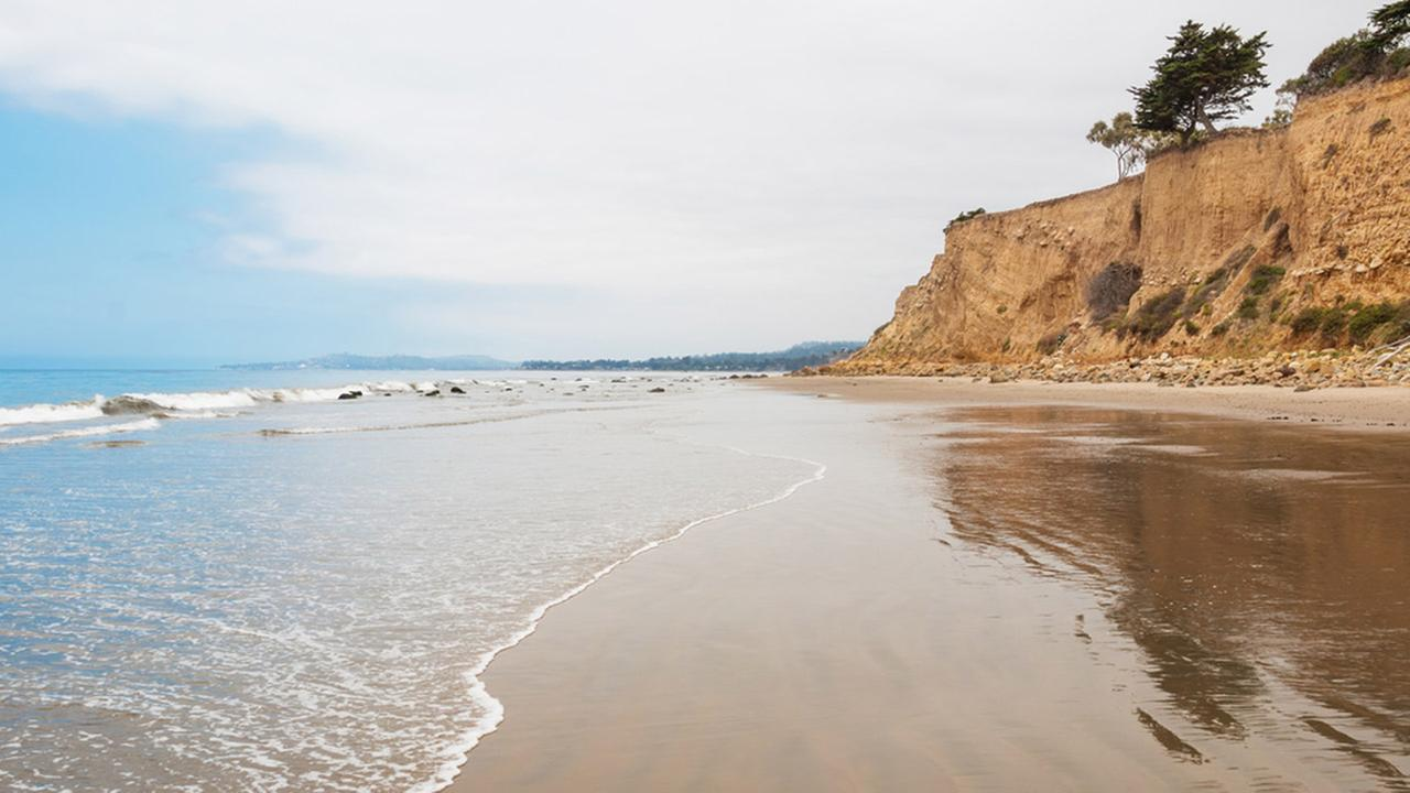 The beach at Loon Point in the seaside village of Summerland, California. Leadbetter Point in Santa Barbara is visible on the horizon.