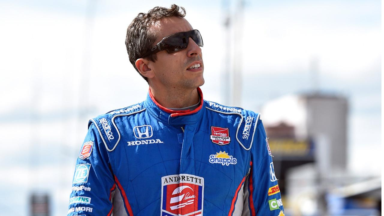 Justin Wilson, of England, walks on pit road during qualifying for Sundays Pocono IndyCar 500 auto race, Saturday, Aug. 22, 2015, in Long Pond, Pa.