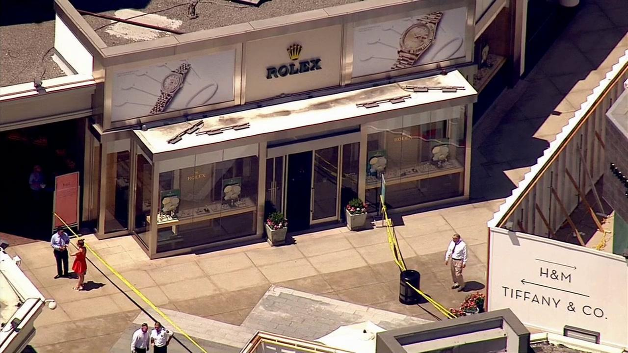 LAPD officers investigate an armed robbery at the Rolex store at the Westfield Century City Shopping Center on Monday, Aug. 24, 2015.