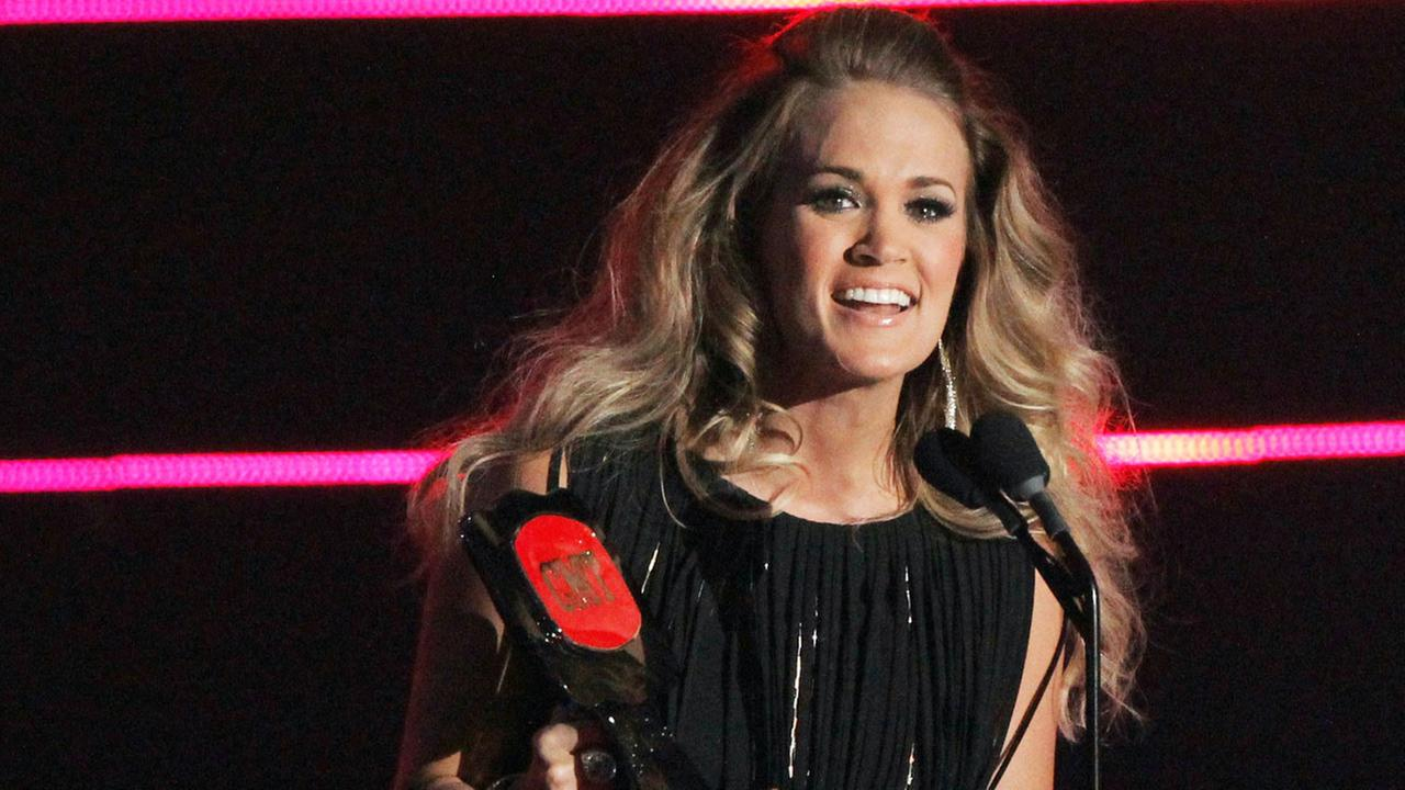 Carrie Underwood accepts the award for video of the year for See You Again at the CMT Music Awards at Bridgestone Arena on Wednesday, June 4, 2014, in Nashville, Tenn.