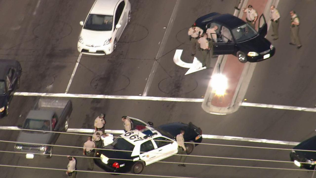 Authorities take a chase suspect into custody at an intersection in Cerritos on Tuesday, Sept. 1, 2015.