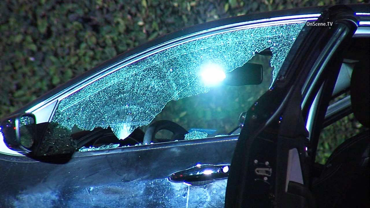 One person was killed and two were injured in a car-to-car shooting in South Los Angeles on Friday, Sept. 4, 2015.
