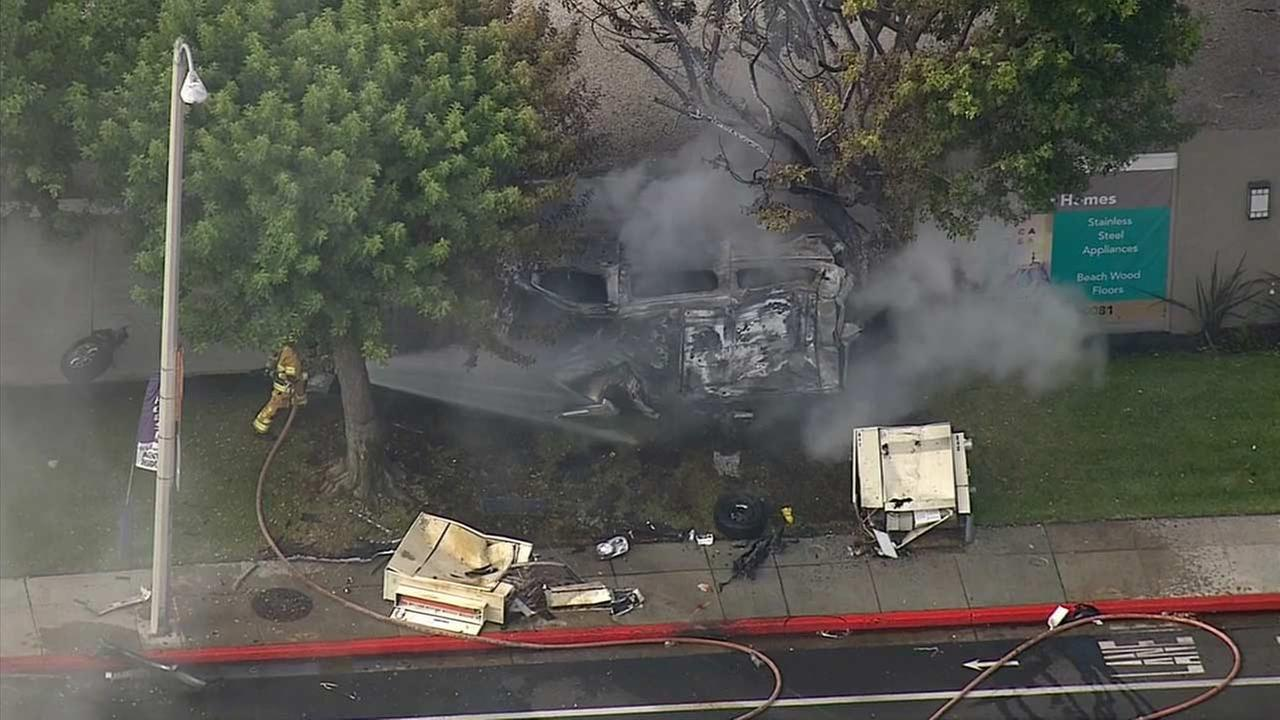 A van slammed into the side of a building, setting both the vehicle and the structures wall on fire in Costa Mesa on Saturday, Sept. 5, 2015.