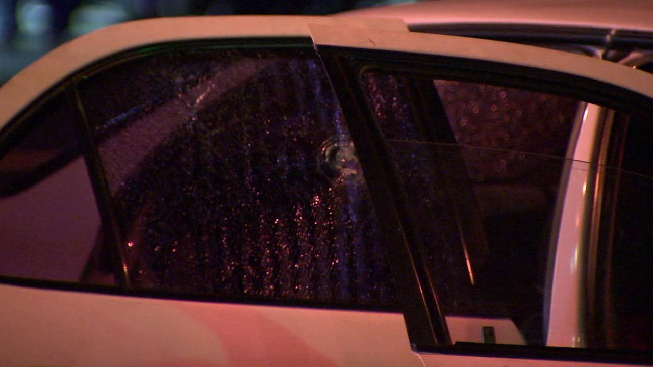 A bullet hole in a rear window of a car is shown after a shooting broke out during a road rage incident in Bell Gardens on Sunday, Sept. 6, 2015.
