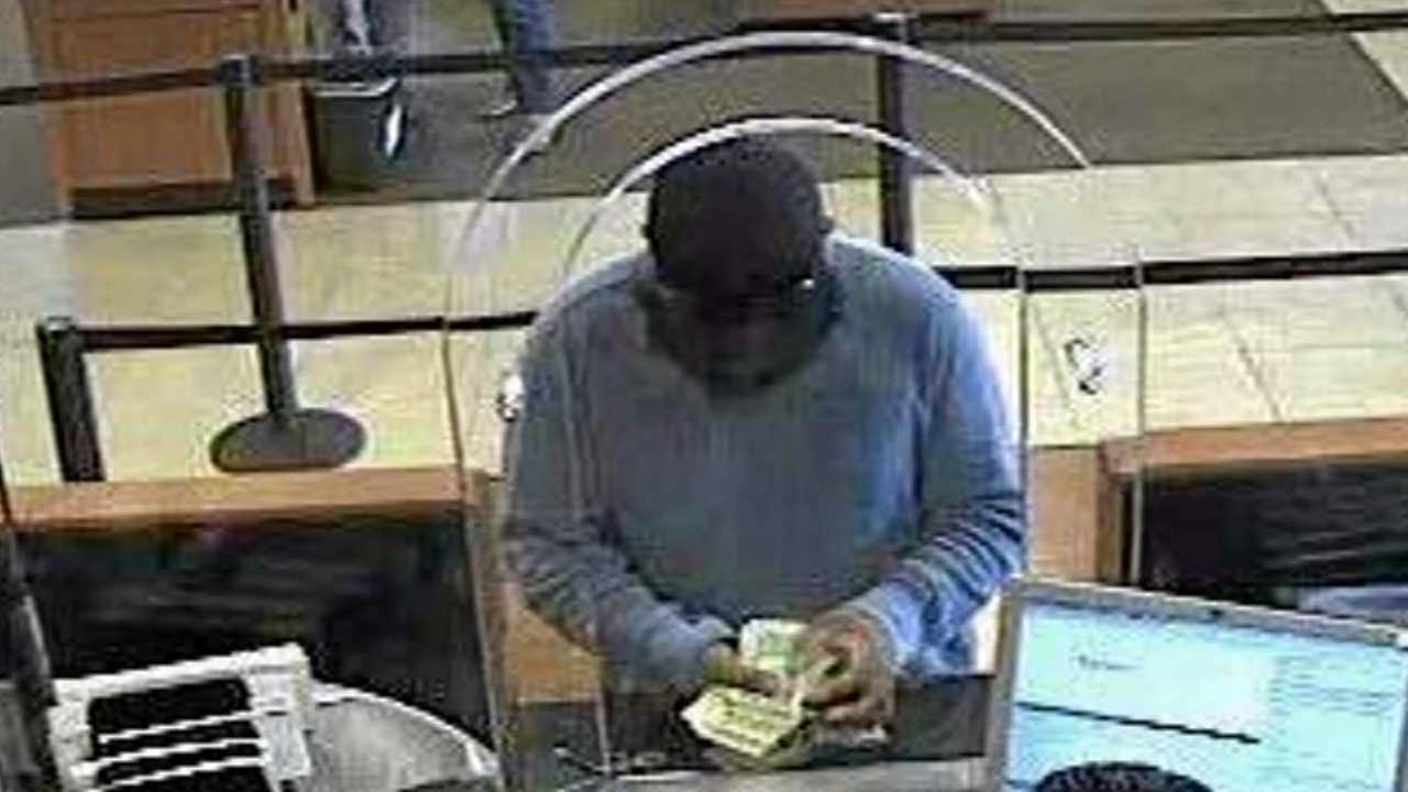 A surveillance still image shows a suspect dubbed the Bluto Bandit during a bank robbery in Southern California.