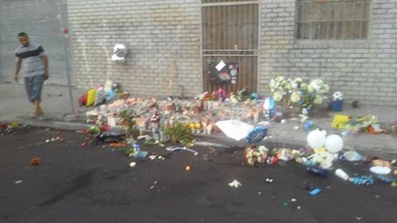 A passerby took this photo Sunday, Sept. 13, 2015, of a vandalized memorial for three boys that were found stabbed to death in South Los Angeles.