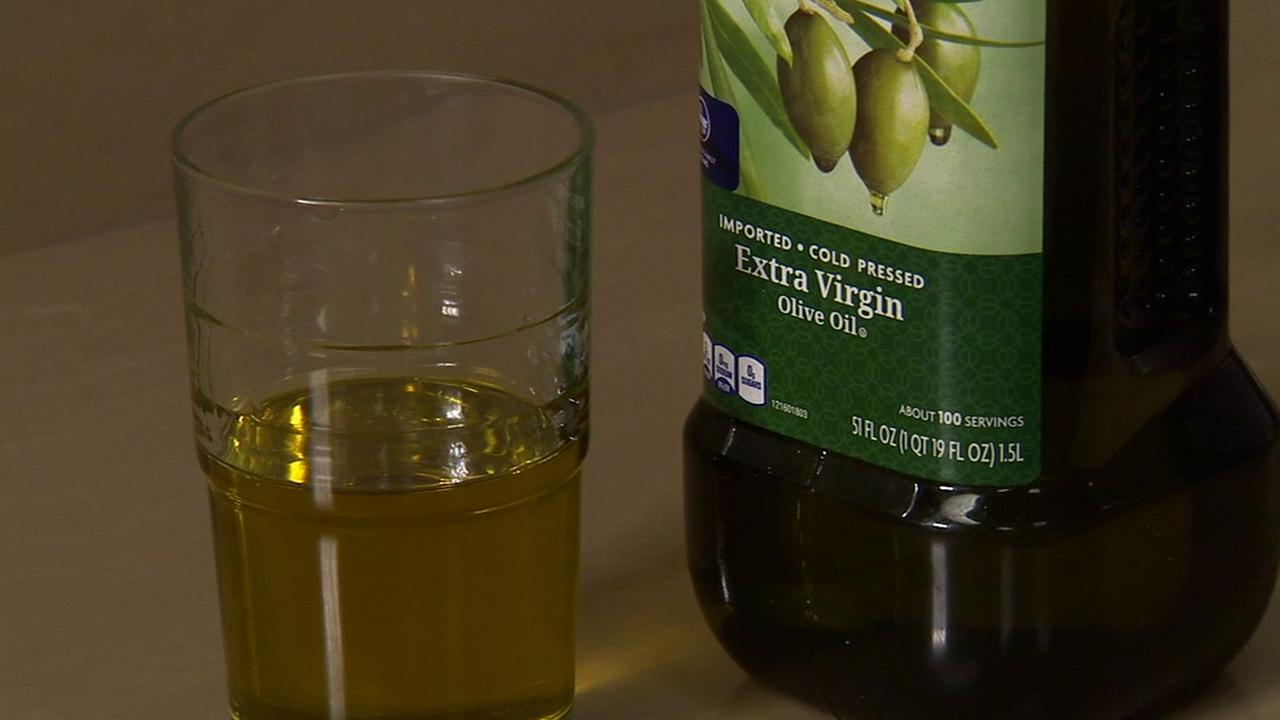 A photo shows 5 ounces of extra virgin olive oil, which was an amount a group of elderly women added to their diet during a 5-year breast cancer study.