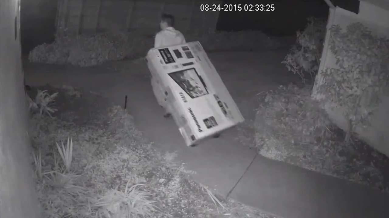 Surveillance video catches a burglar stealing an entertainment center from a home in Pacific Palisades police said Thursday, Sept. 17, 2015.