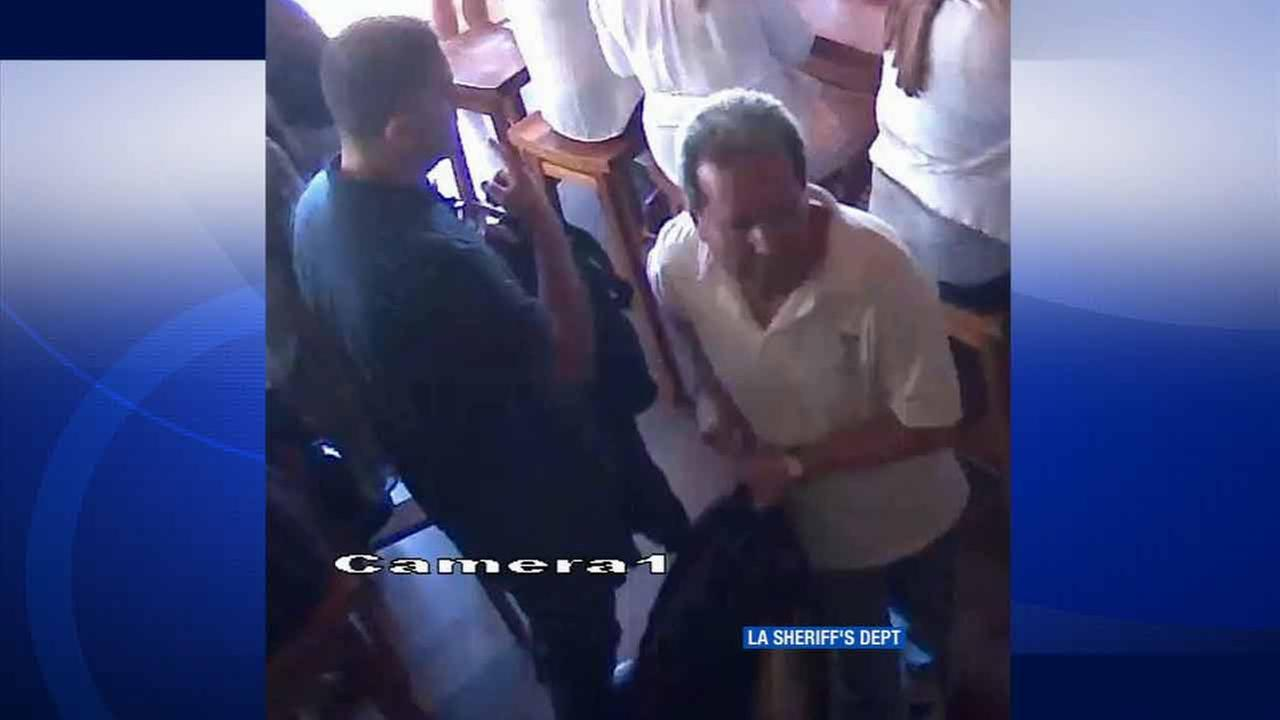 Two suspects caught on surveillance video are seen stealing a womans purse from under a bar stool at a popular Malibu restaurant in August 2015.