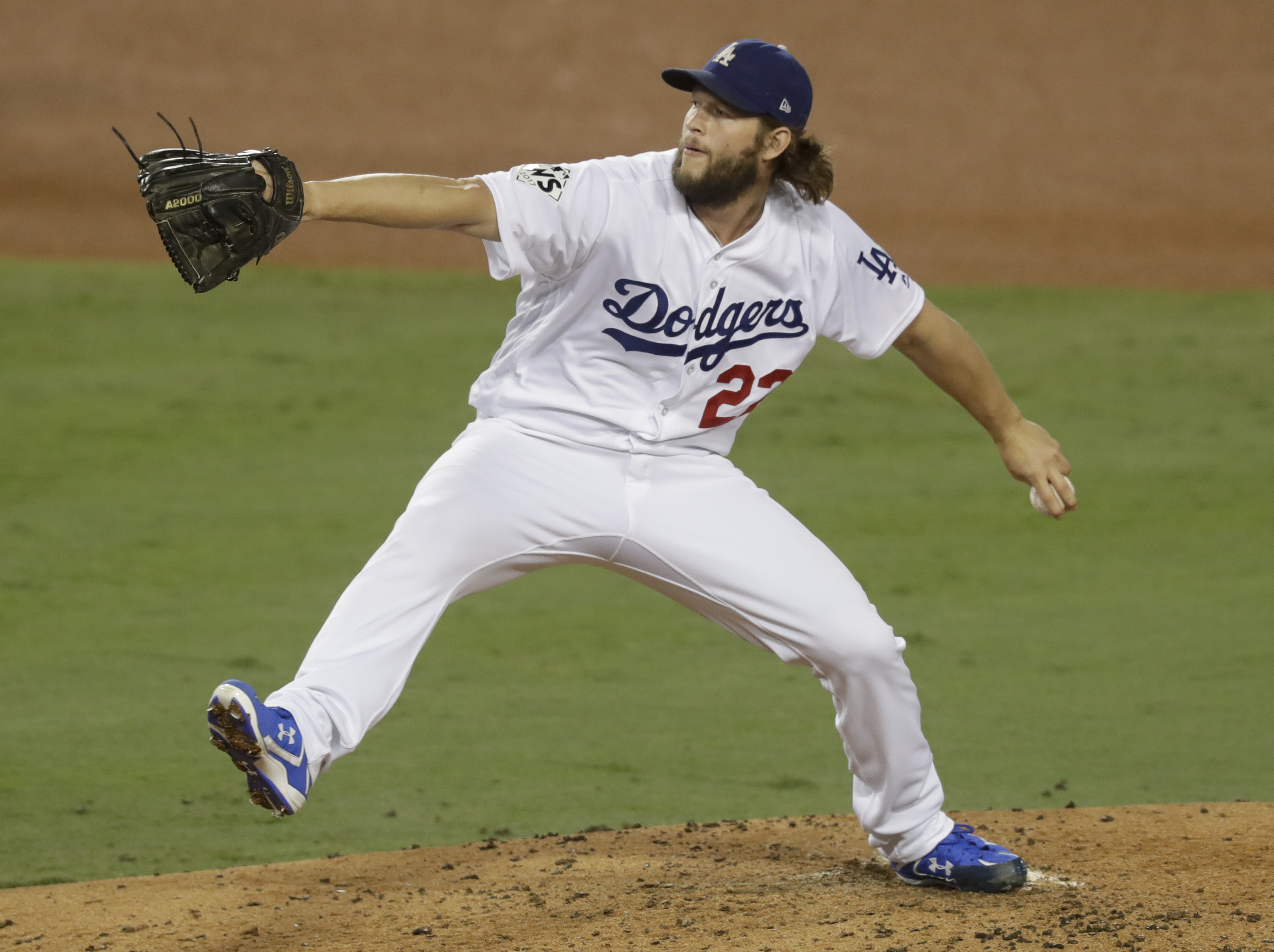 Los Angeles Dodgers starting pitcher Clayton Kershaw throws against the Houston Astros during the third inning of Game 7 of baseballs World Series Wednesday, Nov. 1, 2017.