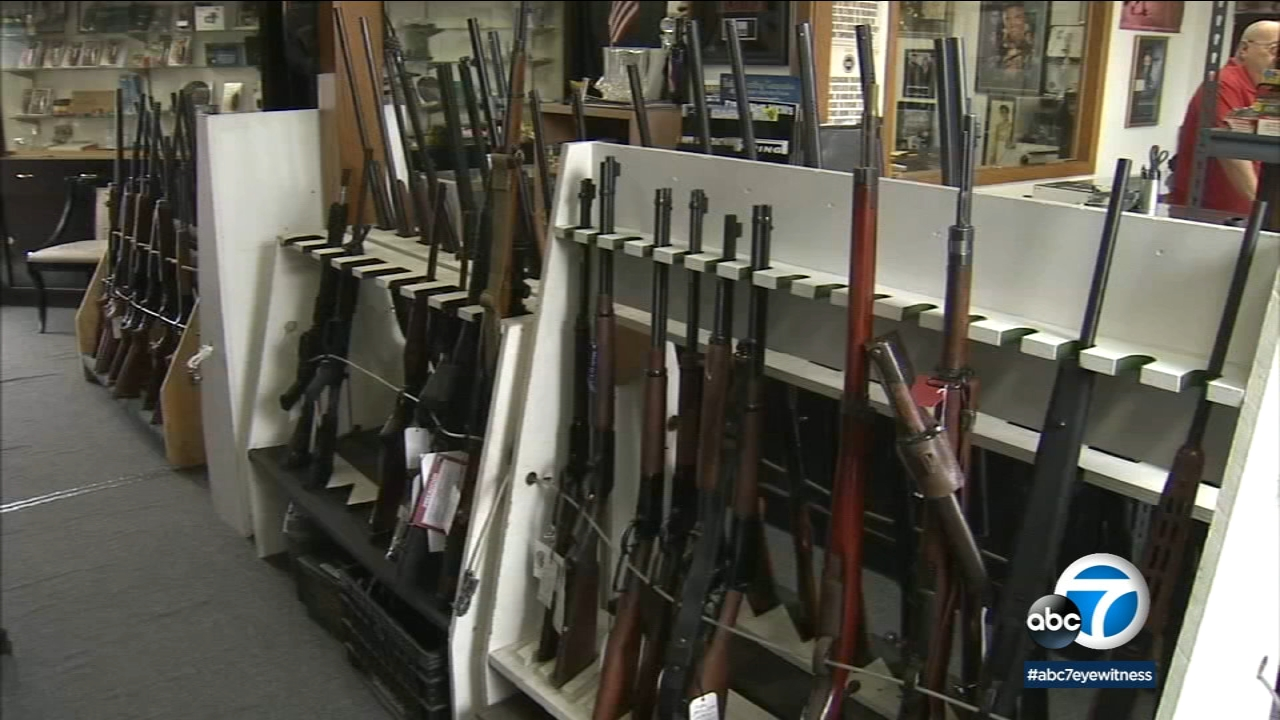 An undated file photo shows rifles inside a gun store.