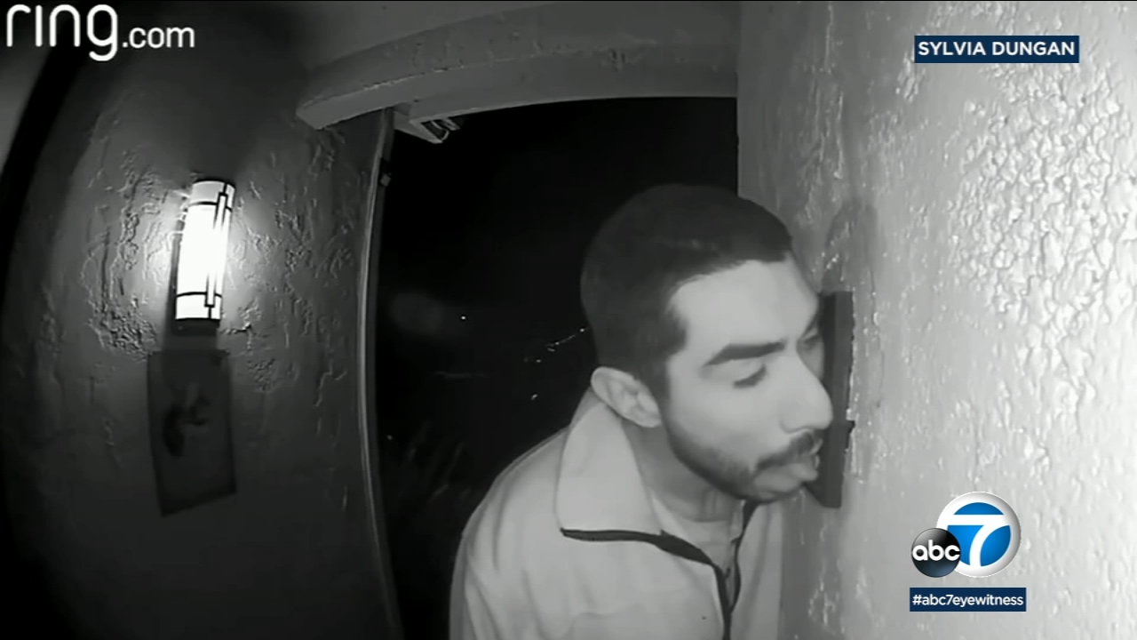 Police are trying to track down a man seen on camera licking a doorbell at a California home for three hours.