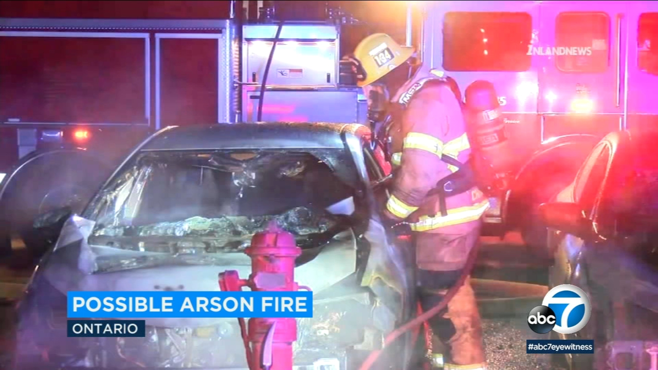 At least seven vehicles were damaged in a possible arson fire that erupted in the parking lot of Azure Hotel and Suites in Ontario early Sunday morning.
