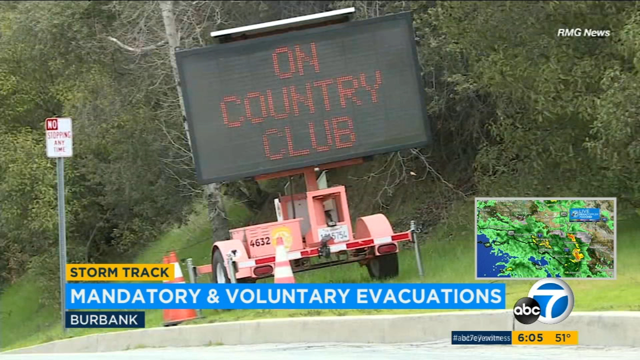 Mandatory evacuations went into effect for a Burbank neighborhood impacted by the La Tuna Fire Tuesday as rain threatened to unleash mud and debris flows.