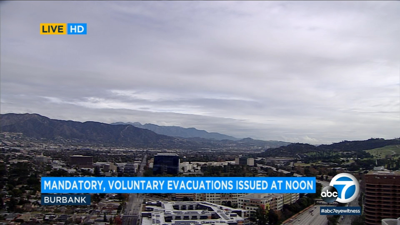 Mandatory and voluntary evacuations were issued for Burbank neighborhoods Tuesday as rain threatens to unleash mud and debris flows.