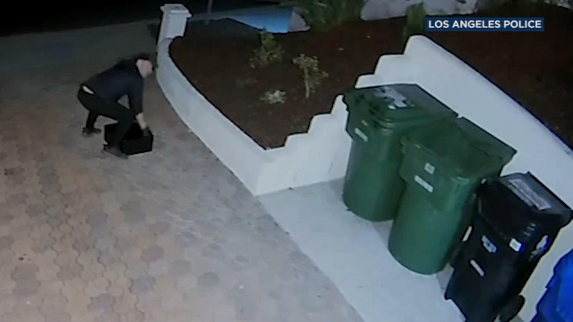 A man is caught on camera burglarizing a home in Encino on Dec. 23, 2019.