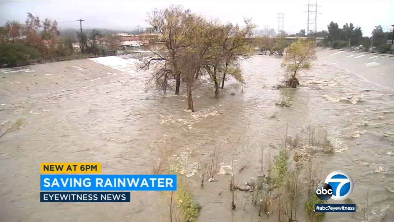 The usually dry L.A. River is seen flowing with water after several days of rain.