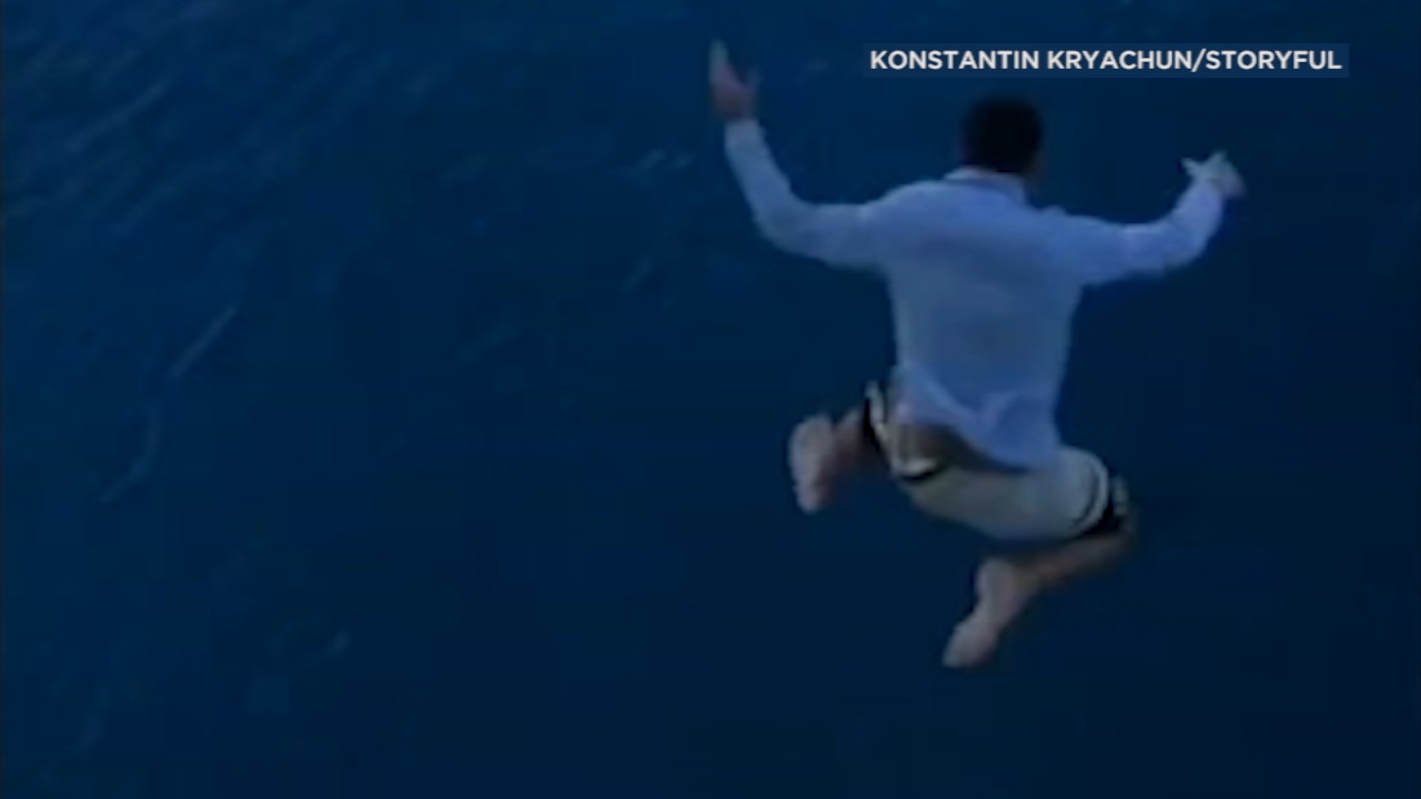 With his friends laughing, a man jumped off the top of a Royal Caribbean ship docked in the Bahamas, plummeting more than 100 feet into the ocean below.