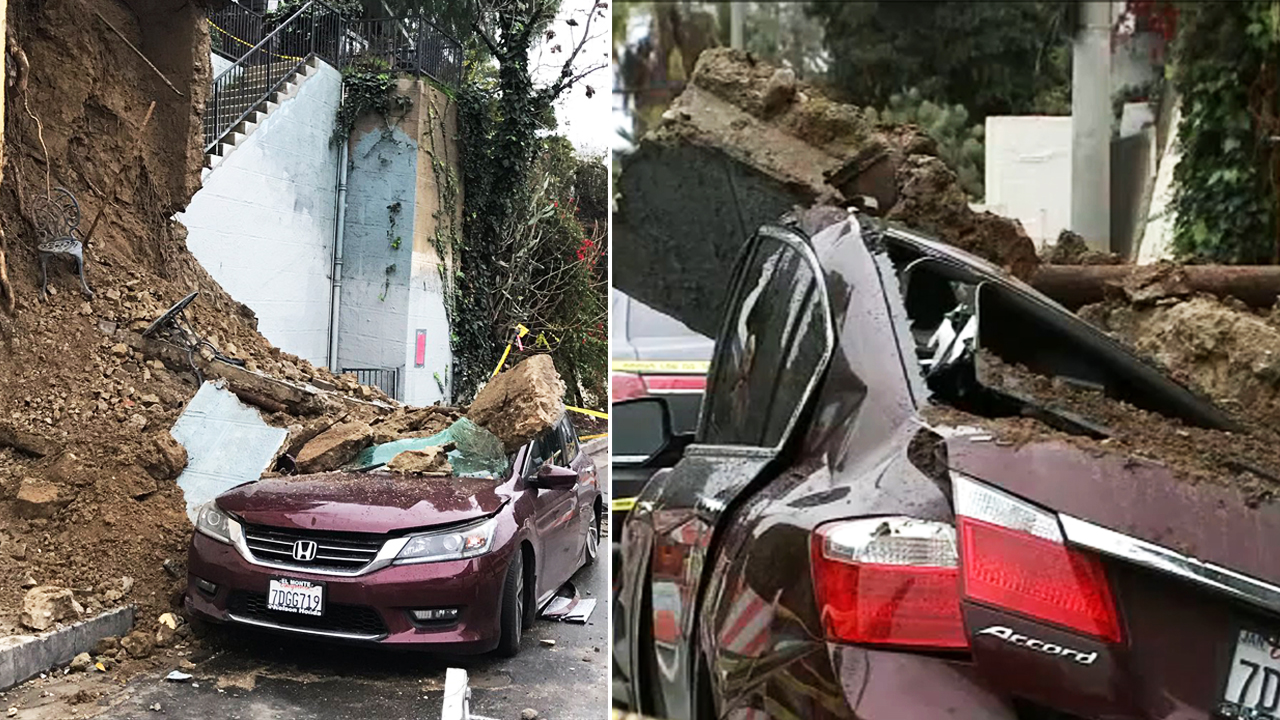 A car is seen crushed after a small mudslide at an Echo Park building on Thursday, Jan. 17, 2019.