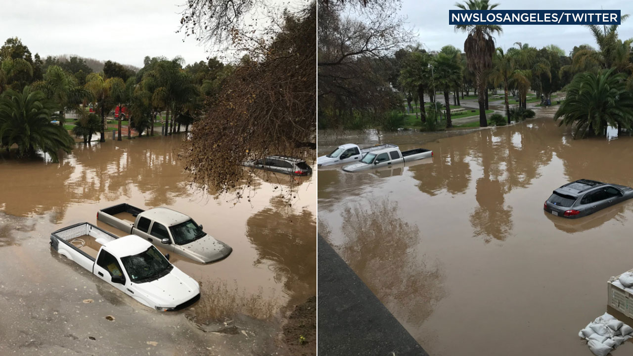 Cars are seen stuck in flood waters at Ventura Beach RV Resort on Thursday, Jan. 17, 2019.