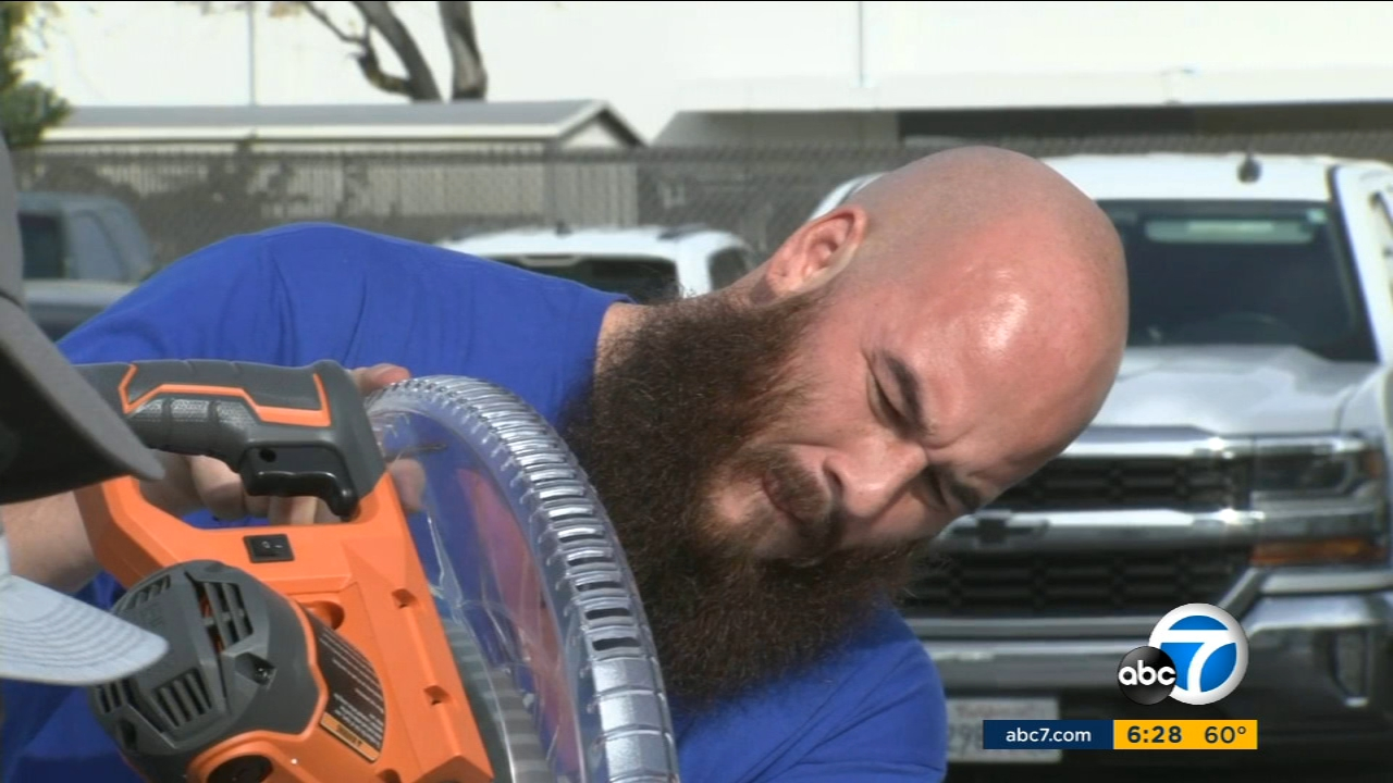 Army veteran Manny Martinez is cutting wood to build shelves for an Orange County organization which helps the homeless.