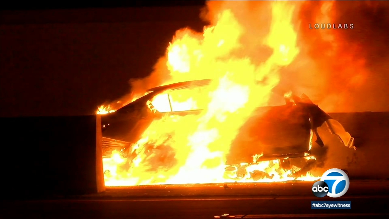 A car is engulfed in flames following a deadly wrong-way crash on the 91 Freeway in Anaheim on Sunday, Jan. 20, 2019.