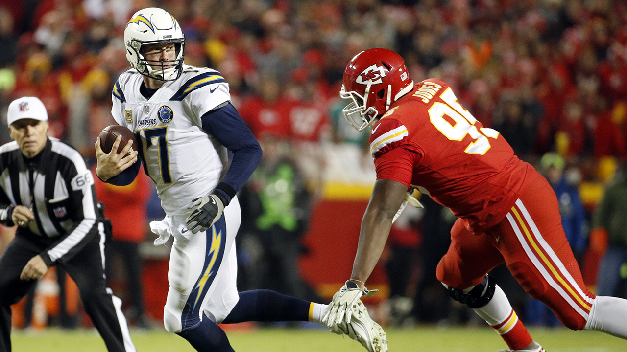 File-This Dec. 13, 2018, file photo shows Los Angeles Chargers quarterback Philip Rivers (17) running away from Kansas City Chiefs defensive end Chris Jones (95).