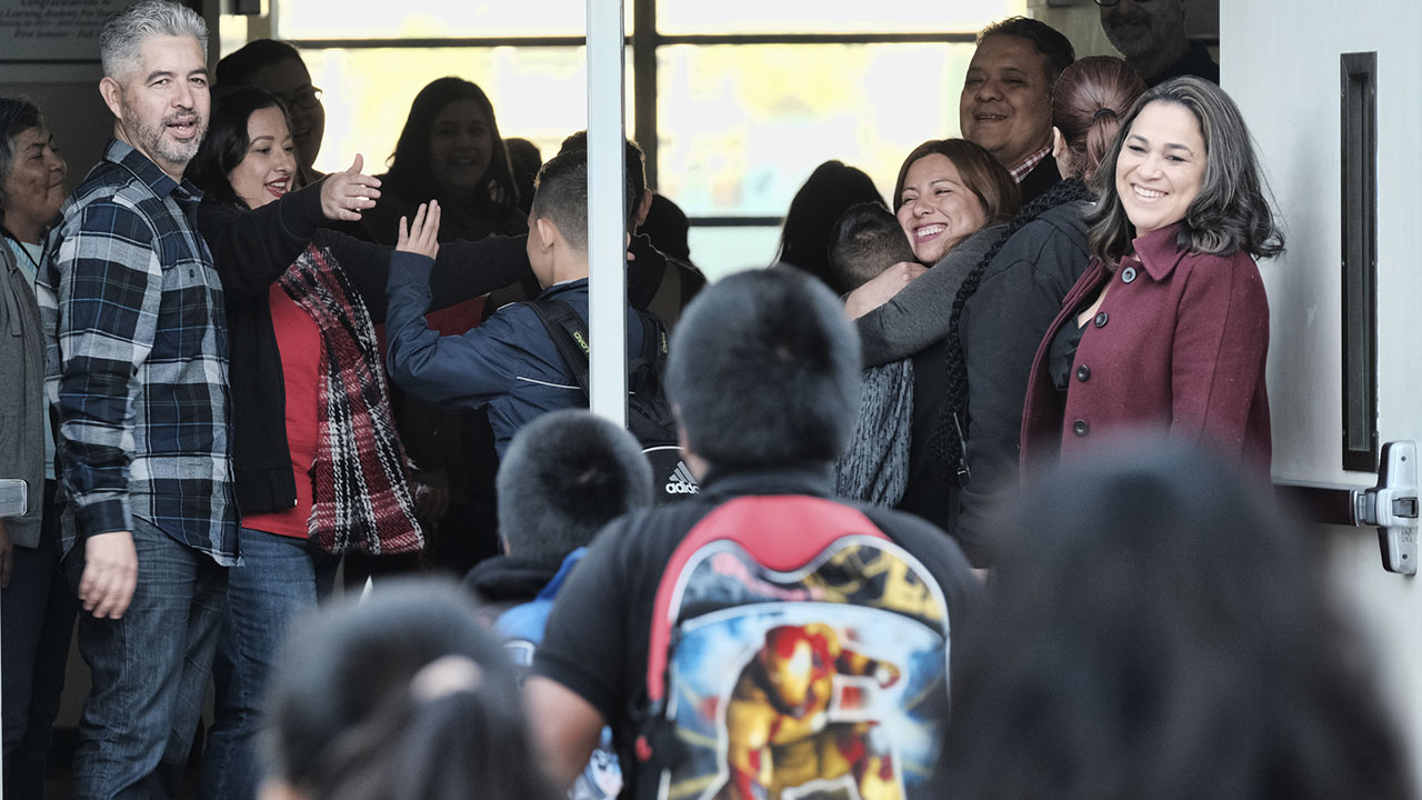 Students are welcomed with high-fives and hugs by teachers and administration upon their return to Evelyn Thurman Gratts Elementary School, Wednesday, Jan. 23, 2019.