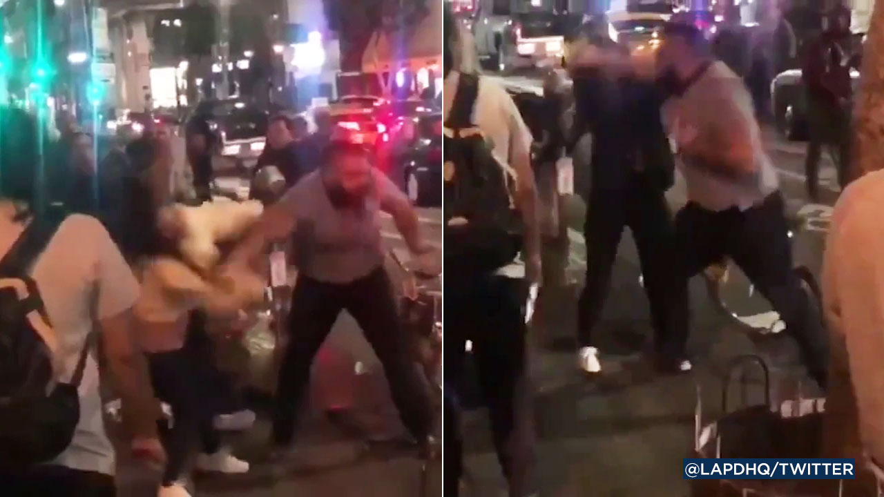 Shocking video shows a man punching two women at a downtown Los Angeles hot dog stand.