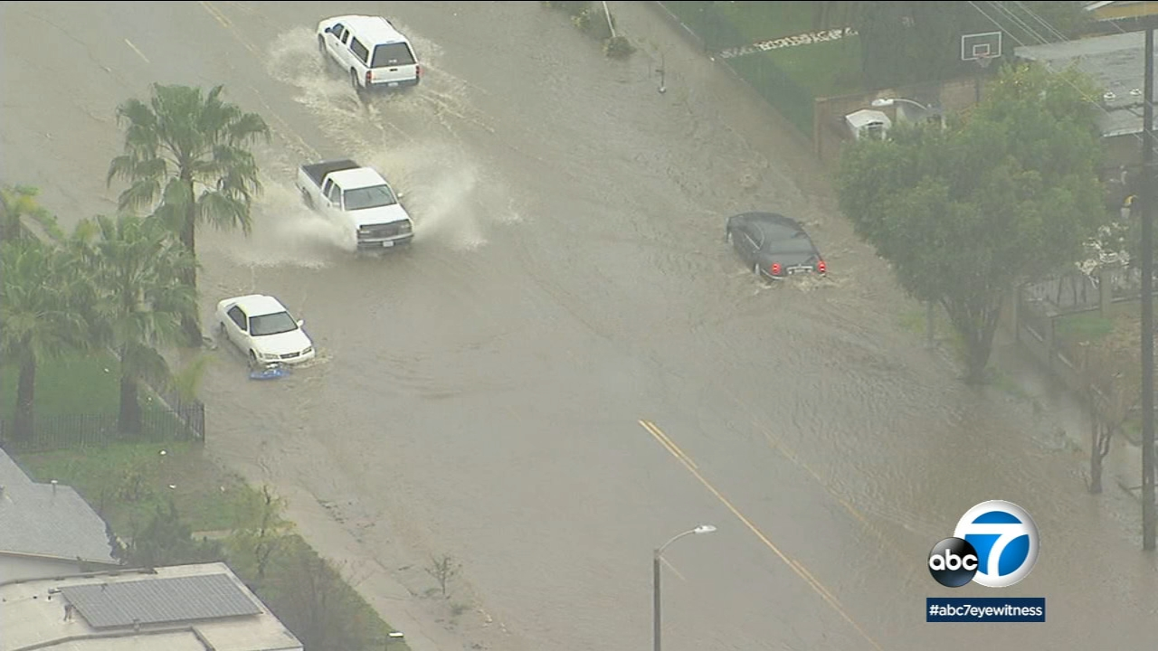 Vehicles are getting stuck in flooded streets in Los Angeles County as a large and severe storm continues to soak Southern California on Saturday, Feb. 2, 2019.